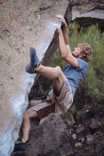 Bouldering in Arico / Tenerife Arico Boulder Bouldering Climbing Climbing A Mountain Day Extreme Sports Mountain One Person Outdoors Real People Rock Rock Climbing Tenerife Young Adult
