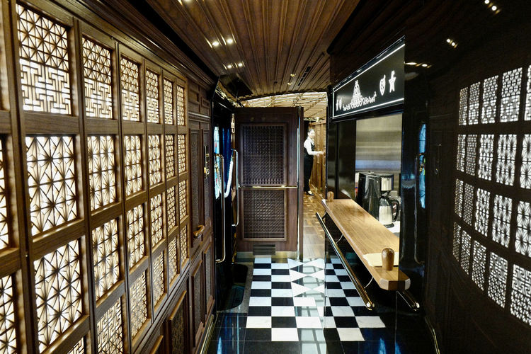 """JR KYUSHU TRAINS Passageway Compartment Car No.2, JR KYUSHU SWEET TRAIN """"ARU RESSHA"""" Interior Design by Eiji Mitooka+Don Design Associates 28mm JR KYUSHU SWEET TRAIN「或る列車」 JR Kyushu ( Kyushu Railway Company ) Luxury Train October 2017 Perspective Illuminated In The Train Modernism Passageway Reflections Retro Styled Wooden Texture 大川組子 Snapshot Today's Hot Look 水戸岡鋭治"""