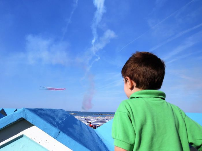 Air Vehicle Airplane Blue Boys Child Childhood Cloud - Sky Flying Headshot Leisure Activity Males  Men Nature Offspring One Person Outdoors Portrait Rear View Sky Transportation Tricolor Arrows Watching