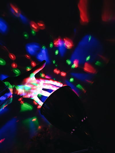 High angle view of illuminated lights at night