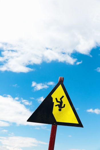 Copy Space Falling High Blue Blue Sky And Clouds Cloud - Sky Communication Crash Risk Day Falling Down Low Angle View Nature Outdoors Pole Safety Shape Sign Sky Symbol Symbolic  Symbolism Triangle Shape Warning Symbol White Color Yellow
