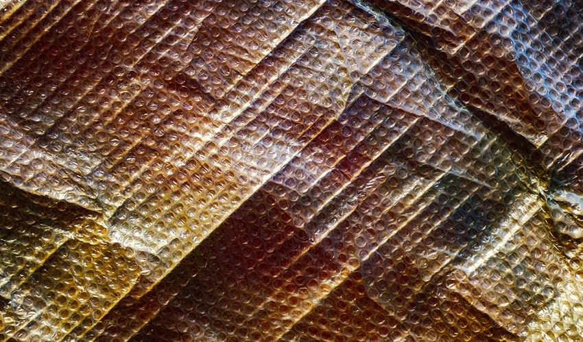 bubble wrap on paper Bubble Wrap On Paper Wrapped Backgrounds Full Frame Pattern No People Textured  Close-up Brown Day Outdoors Rough Nature Natural Pattern Sunlight Wood - Material Leaf Beauty In Nature Detail Striped Low Angle View
