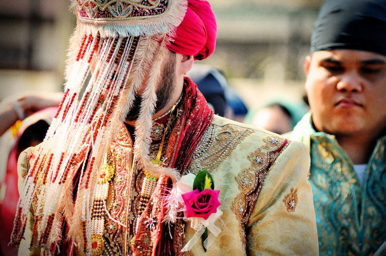 Groom in traditional clothing during wedding
