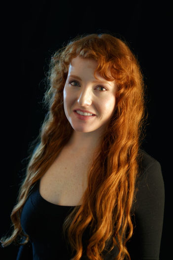 Black Background Redhead Adult Adults Only Beautiful Woman Beauty Black Background Close-up Curly Curly Hair Day Fair Skin Ginger Happiness Headshot Indoors  Long Hair Looking At Camera Medium-length Hair One Person One Young Woman Only People Portrait Real People Red Hair Redhead Smiling Studio Shot Young Adult Young Women