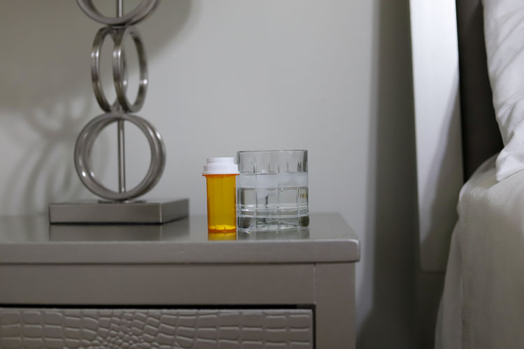 Close-up of bottles on table at home