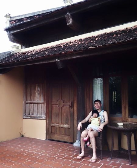 On Vacation Full Length Sitting Architecture Looking At Camera Built Structure My Best Photo Real People Portrait Front View Casual Clothing Leisure Activity Lifestyles Building Exterior House Building Smiling Outdoors