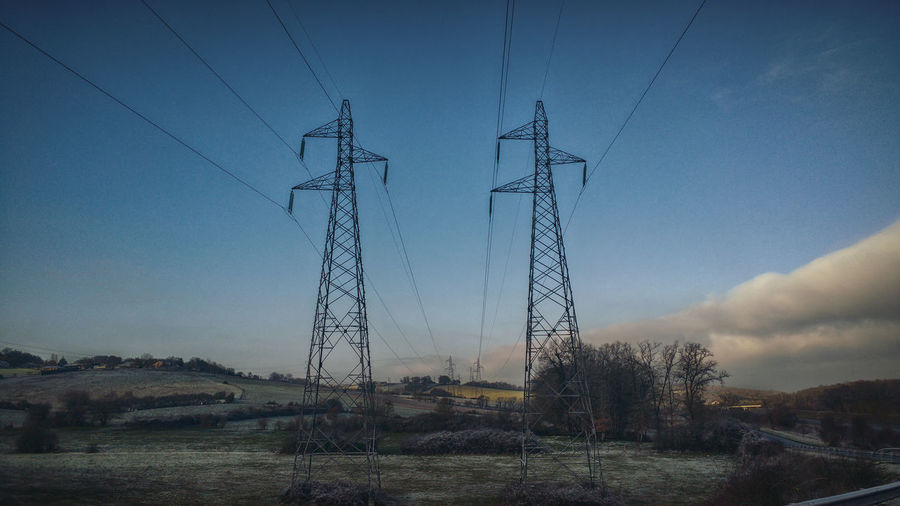 electricity landscape Cable Connection Day Electricity  Electricity Pylon Electricity Tower Field Fuel And Power Generation Landscape Low Angle View Nature No People Outdoors Power Line  Power Supply Rural Scene Sky Technology Tree