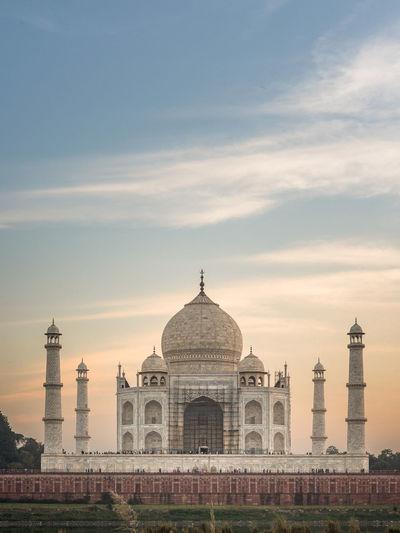 Taj mahal against sky during sunset