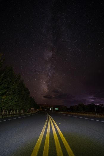 Stormy Interference. Night Star - Space Milky Way The Way Forward Astronomy Sky Beauty In Nature Nature Scenics Road Galaxy Tree Landscape No People Space Outdoors Star Field Constellation Utah Utahgram Bluff Storm Storm Cloud Lightning Roadtrip