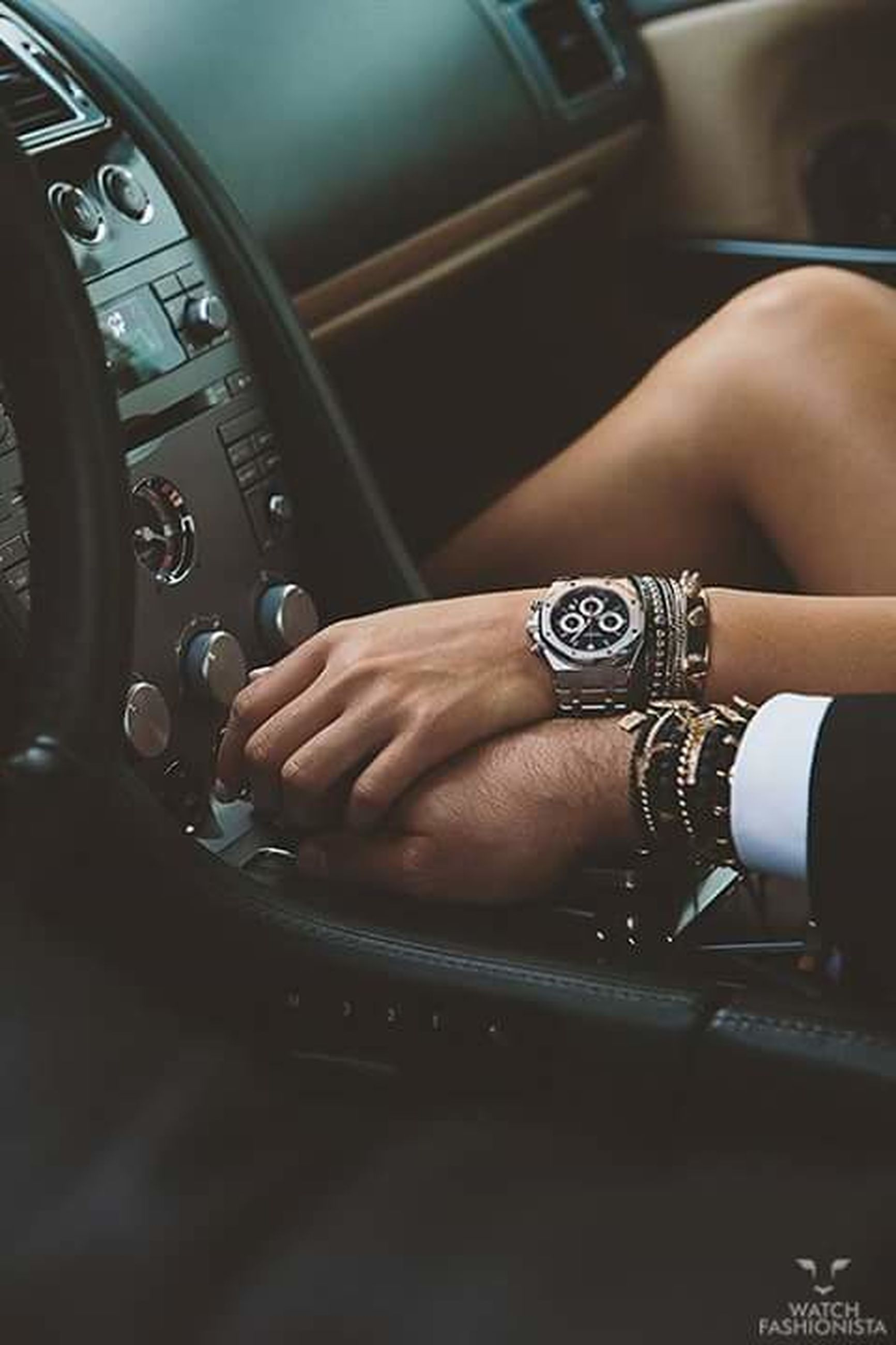 indoors, person, part of, lifestyles, cropped, leisure activity, holding, men, human finger, technology, close-up, sitting, vehicle interior, midsection, wireless technology, wristwatch