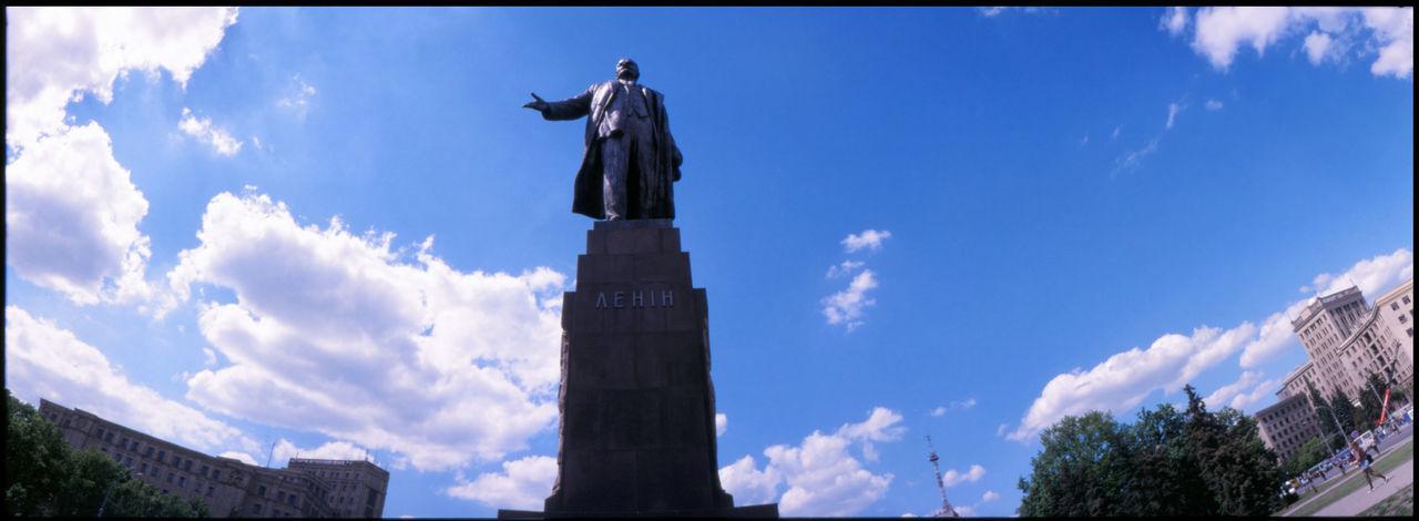 statue of vladimir lenin on high pedestal