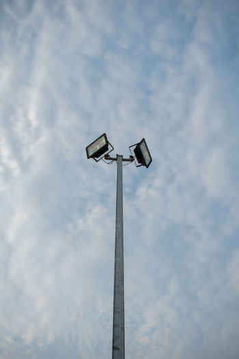 Low Angle View Sky Cloud - Sky Lighting Equipment Floodlight Technology Pole No People Street Light Outdoors Street Nature Security Camera Day Electric Light Tall - High Light Electricity  Security System Surveillance Electrical Equipment Power Supply Electric Lamp