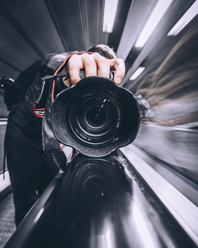 Close-up of man photographing camera