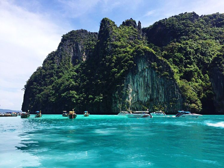 Maya-Bay 🏖 Water Vacations Real People Adventure Sea Outdoors Nature Tree Leisure Activity Beauty In Nature Day Sky Scuba Diving People Island Wave View Likeforlike Maya Bay Phuket Speed Boat Lifestyles Mountain