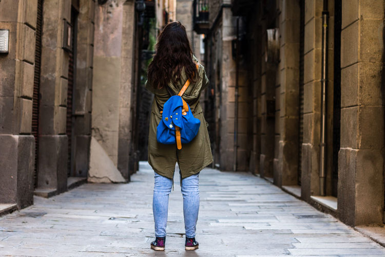 Rear View One Person Casual Clothing Outdoors Full Length Blue One Woman Only City People Adults Only One Young Woman Only Leisure Activity Only Women Built Structure Back Women Tree Adult Architecture Street Photography Young Women Beautiful Woman Lifestyles Barcelona Portrait Of A City
