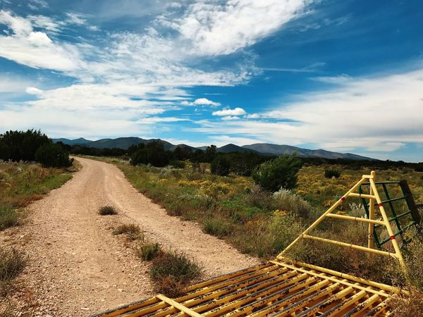 """""""Across The Guard To Heaven"""" A rural cattle guard is the last barrier to the mountains and Juniper Woodlands of Central New Mexico beyond. The Way Forward Sky Tranquil Scene Landscape Scenics Outdoors Mountain Cattleguard Country Road Newmexico Newmexicoskies Newmexicophotography Cloud - Sky Ruralroads"""