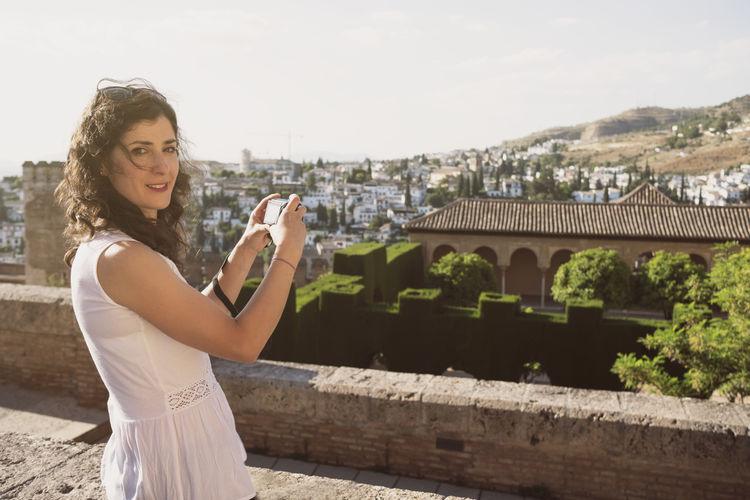 Portrait of woman standing on building terrace