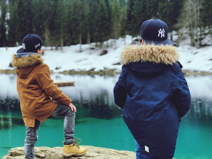 Winter Warm Clothing Cold Temperature Real People Snow Clothing Inner Power Knit Hat Rear View Men Outdoors People Standing Focus On Foreground Lifestyles Tree Leisure Activity Nature Day Hood - Clothing Hat This Is Family