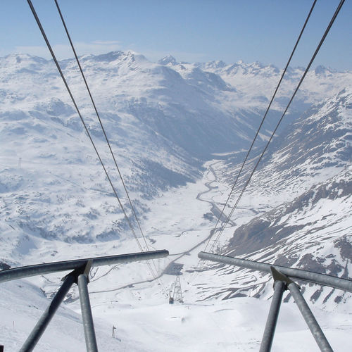Overhead cables on snowcapped mountain