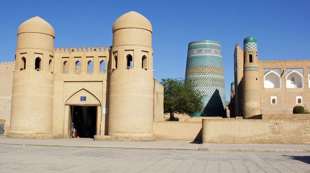 Gate to the ancient city of Khiva, silk road, Uzbekistan, Central Asia Ancient Ancient Architecture Building Exterior Built Structure Central Asia City Day Desert Oasis Famous Place Gate Khiva Middle East Minaret Old Old Buildings Oriental Outdoors Silk Road Tourism Tourist Attraction  Town Travel Travel Destinations Uzbekistan