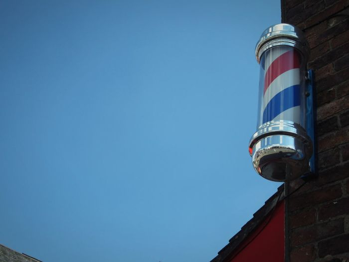 Low angle view of traditional barber pole