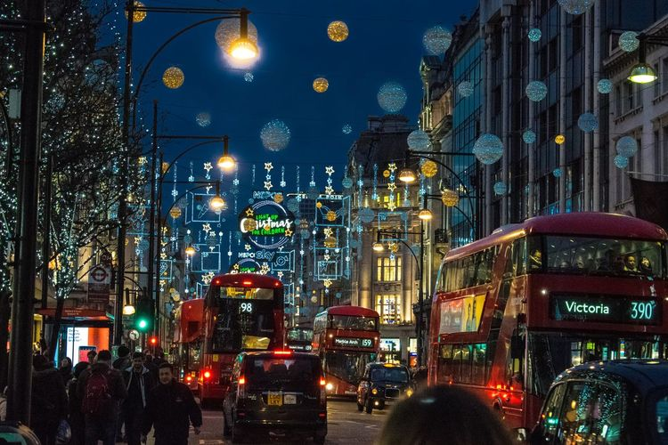 Oxford St Architecture Building Exterior Built Structure Car Christmas Decoration City City Life City Street Illuminated Incidental People Land Vehicle Light Lighting Equipment Mode Of Transportation Motor Vehicle Night Outdoors Real People Road Street Street Light Traffic Transportation