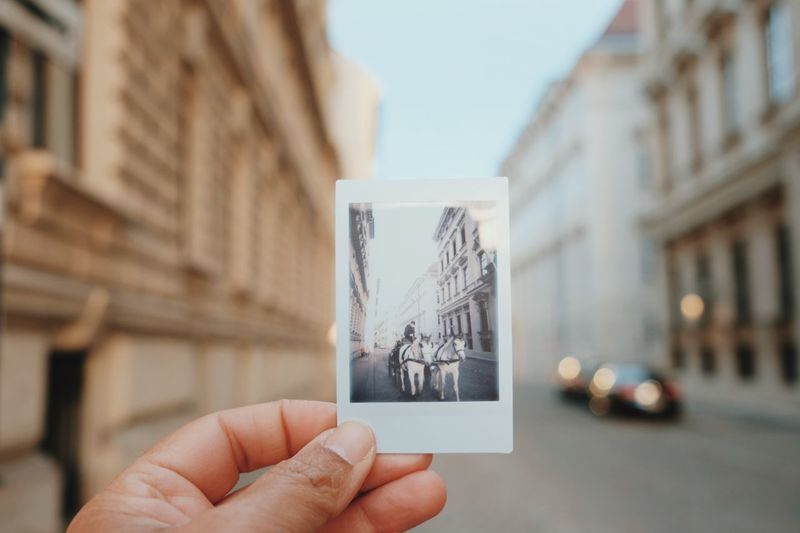 vienna classic Austria Vienna Streetphotography Polaroid Fiaker Streetphoto_color EyeEm Selects Human Hand Hand Human Body Part Focus On Foreground Holding A New Perspective On Life Personal Perspective Architecture