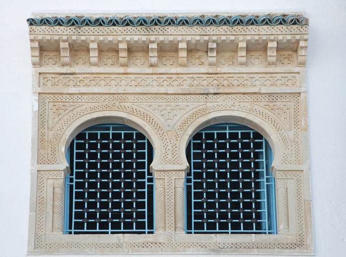 Traditional window from Kairouan, Tunisia Africa Arch Architectural Feature Architecture Blue Brick Wall Building Exterior Built Structure City Historic House Islamic Kairouan Ornament Ornate Town Traditional Tunisia Window