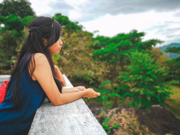 Side view of teenage girl at observation point