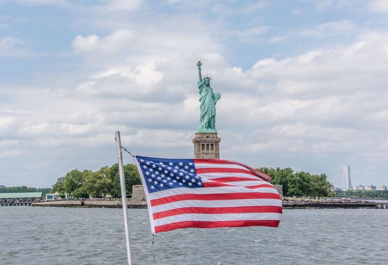 Flag Patriotism Cloud - Sky Striped Independence National Icon Sky Freedom Pride Stars And Stripes No People Day Outdoors Travel Destinations Water Built Structure Architecture