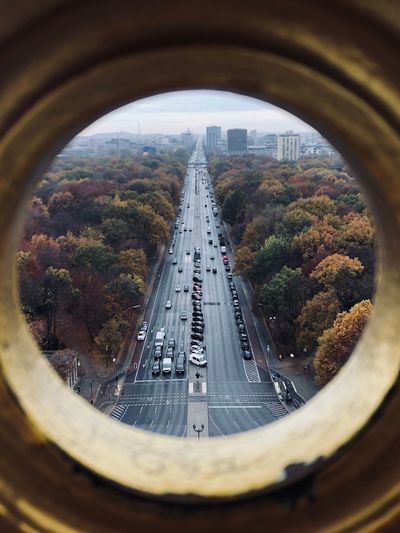 Highway In City Seen Through Hole