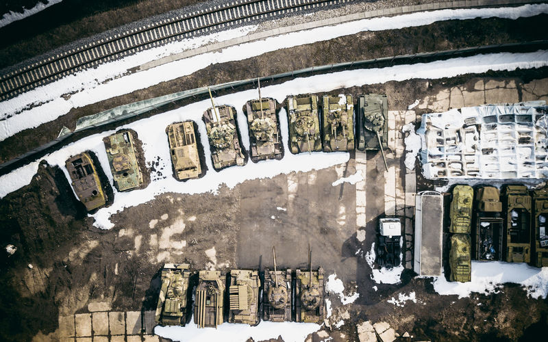 Directly above shot of abandoned armored tanks in snow