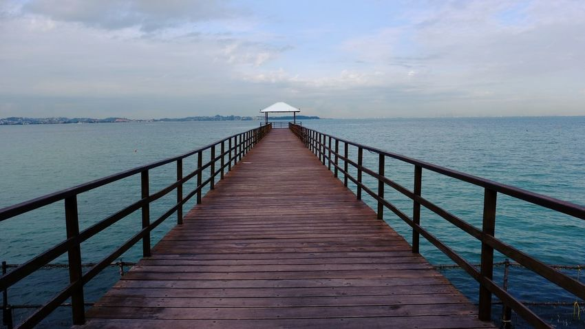 Sea Jetty Beauty In Nature Nature Water Blue Scenics Pier Outdoors Landscape Sky Horizon Over Water No People Beach Day Wheelchair Access Dramatic Angles Magic Hour Batam Island Batam-Indonesia INDONESIA Lost In The Landscape