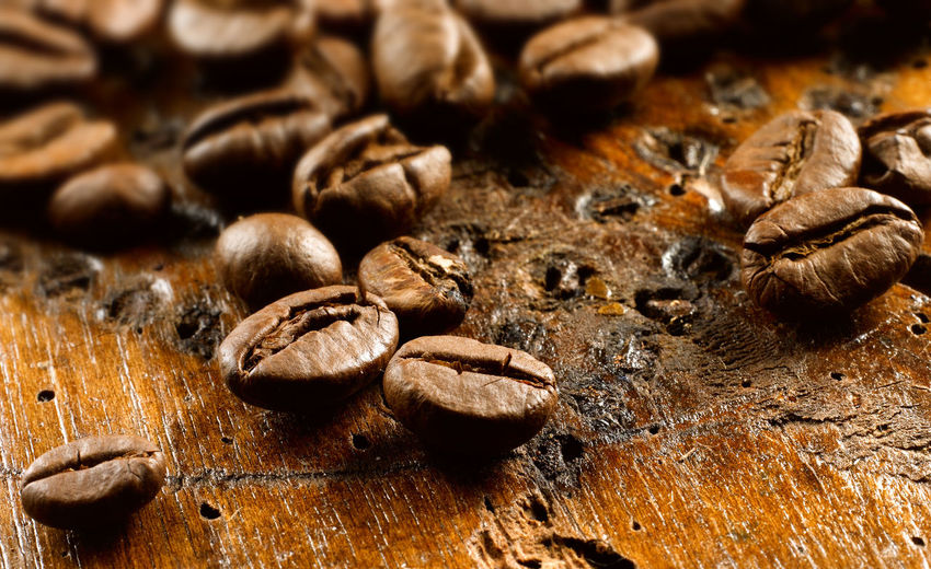 Detail shot of coffee beans on table