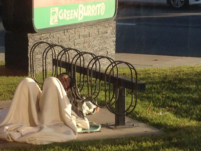 woman laying down ta bike rak at Carls Jr restaurant January 31, 2018 Bike Rack Blight Poor  Woman Blanket Day Disturbed Fast Food Restaurant Grass Homeless Homelessness  Human Representation Lawn Mentally Ill One Person Outdoors People Poverty Reclining Social Issues Text Transient Transients Vagrancy Vagrant