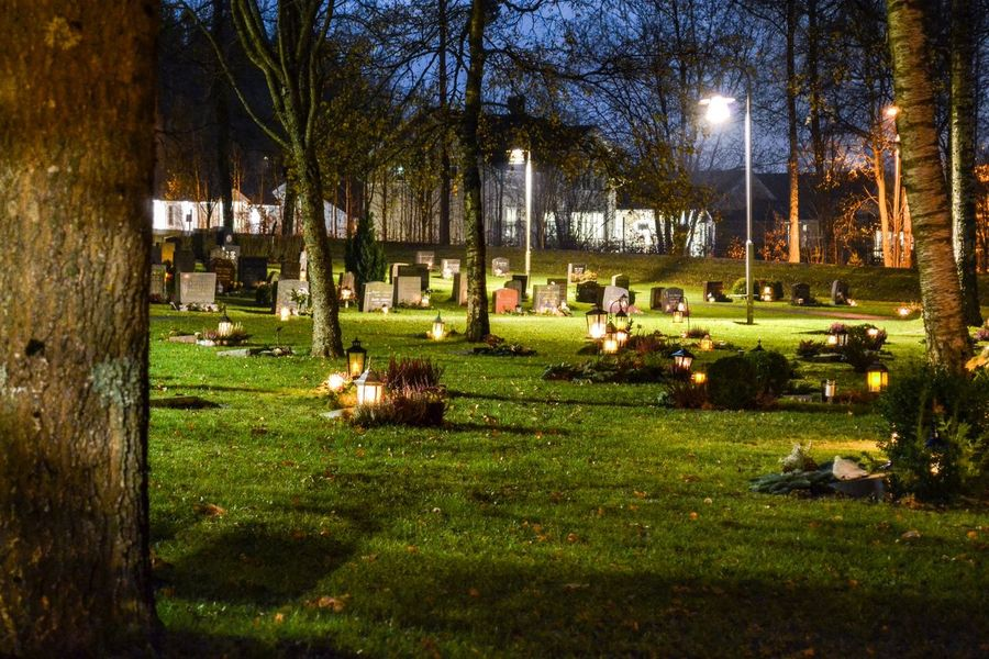 Graveyard Grave Graveyard Graves Gravestone Grief Sadness Sorrow Honour Honouring The Dead Candles Candlelight All Saints Day All Saints  All Saints' Day Grieving No People Lighting Equipment Outdoors Grave