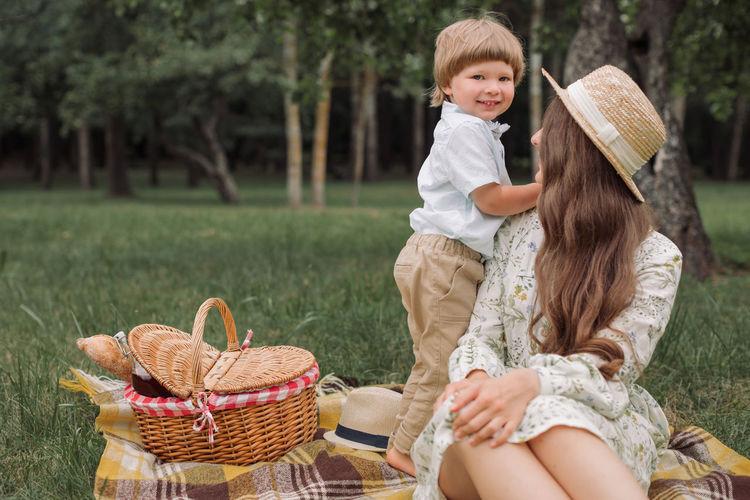 Full length of woman sitting in basket