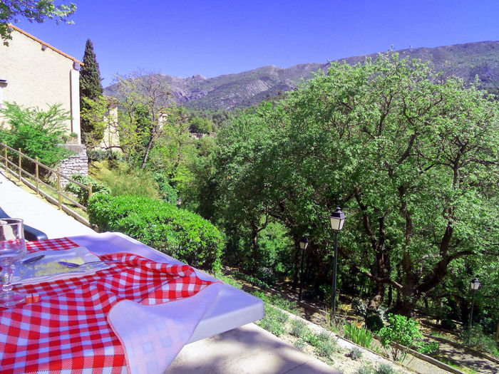 Beauty In Nature Bistro Cafe Clear Sky Day Dining France Growth Landscape Mountain Nature Outdoor Cafe Outdoors Red Checkered Scenics Sky Summer Sunlight Tablecloth Tranquility Tree Vacation View
