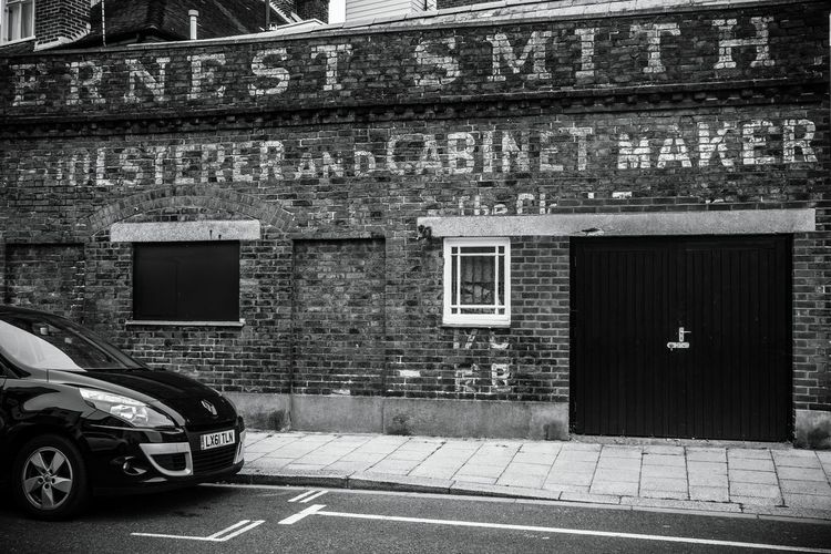 Painted wall sign Streetphotography Streetphoto_bw Black&white Blackandwhite Wall