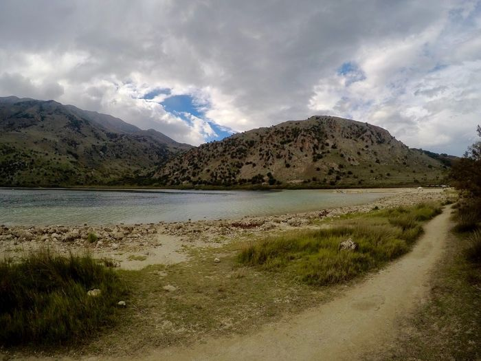 Lake in Crete, Greece Water Sky Cloud - Sky Mountain Beauty In Nature Scenics - Nature Plant Tranquility Nature Landscape Tranquil Scene No People Environment Day Lake Outdoors Land Grass Non-urban Scene First Eyeem Photo