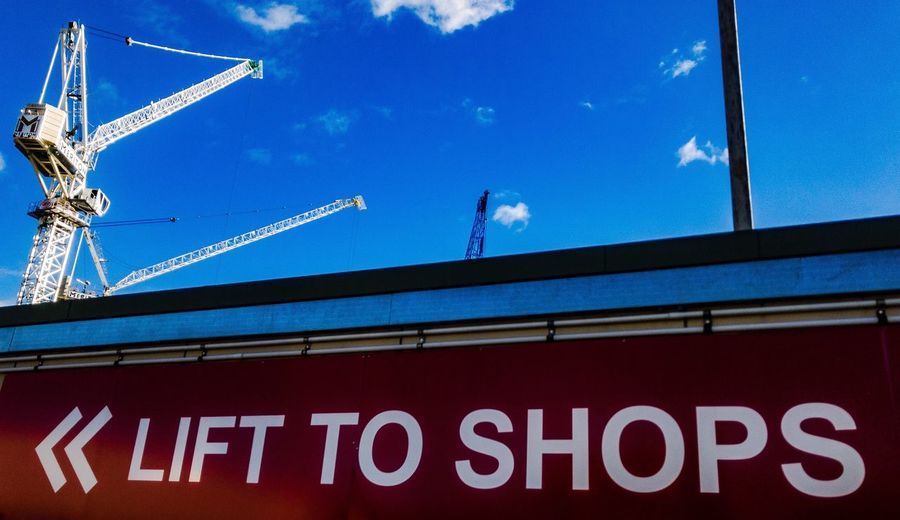 IPhoneography Iphoneonly IPhone7Plus Architecture Text Built Structure Travel Building Exterior Low Angle View Tourism Day City Outdoors Sky No People Eric Imbs Ericimbs Conceptual Crane