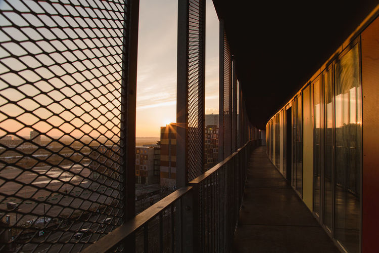Low angle view of corridor against sky during sunset
