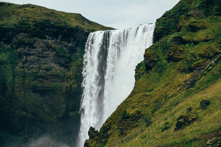 Skógafoss Iceland Adventure Beauty In Nature Cliff Day Environment Long Exposure Motion Nature No People Outdoors Power In Nature Rapid River Scenics Skogafoss Sky Tourism Travel Water Waterfall