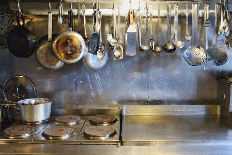Kitchen Utensils Hanging At Home
