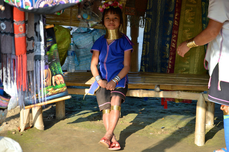 Architecture ASIA Built Structure Casual Clothing Childhood Destination Front View Full Length Lifestyles Looking At Camera Person Portrait Smiling Spotted In Thailand Standing Three Quarter Length Travel Wood - Material Young Adult Young Women