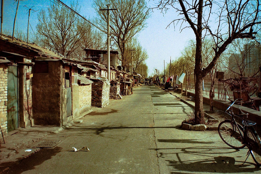 took this picture 20 years ago in Beijing Bare Tree Beijing Built Structure Clear Sky Diminishing Perspective Empty Empty Road Eyeemphoto Footpath Hutong Hutong Street Long Time Ago My Beijing 1996/97 Old Buildings Old Photos Old Picture Outdoors Past Time Peking  Poverty Simple Life Simplicity Strolling The Way Forward