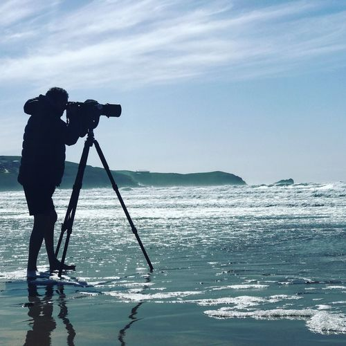 Photographer Beach Photography Camera - Photographic Equipment Water Photography Themes Occupation Tripod Sky Photographing Silhouette One Person Photographer Photographic Equipment Full Length Camera