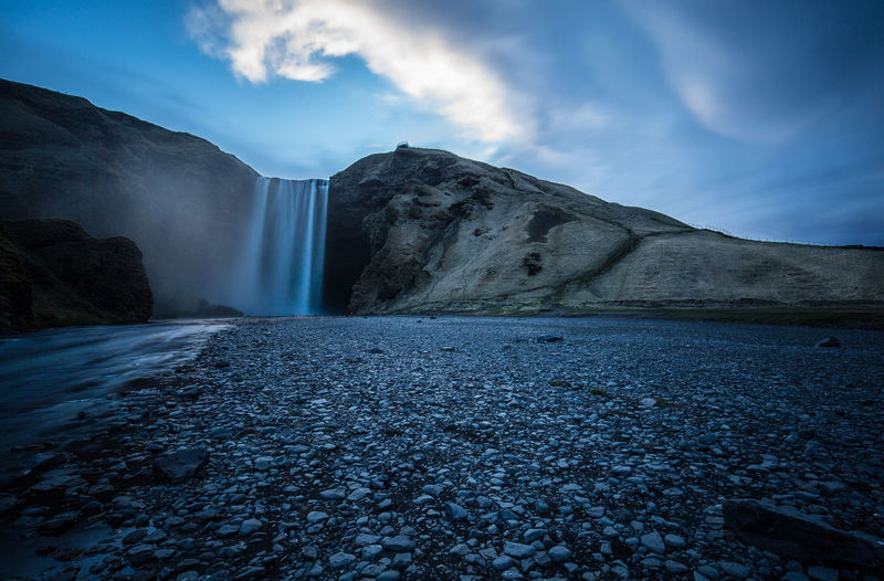 Beauty In Nature Cloud - Sky Day Iceland Long Exposure Motion Mountain Nature No People Outdoors Scenics Sky Tranquil Scene Tranquility Water Waterfall