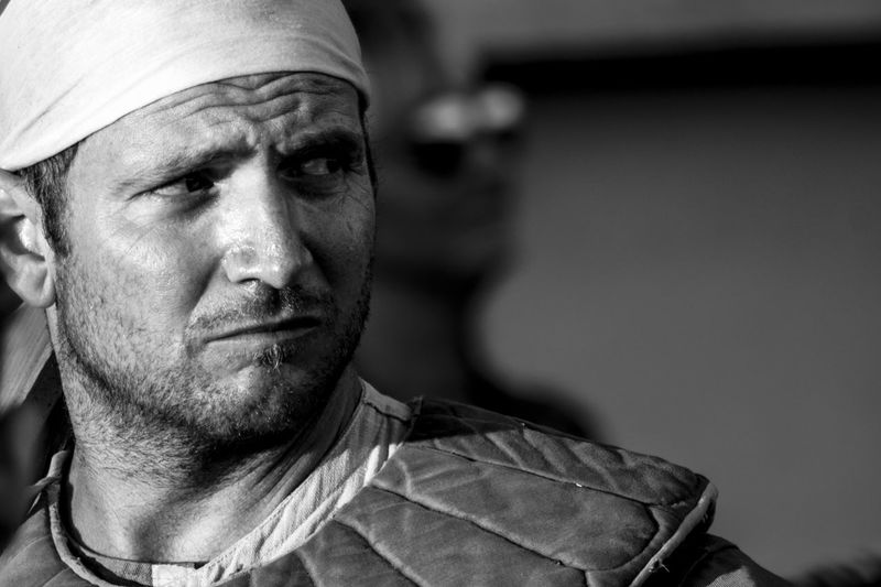 Close-up portrait of man wearing bandana