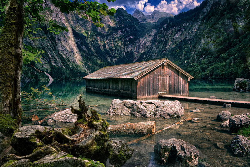 Scenic view of house in lake against mountain